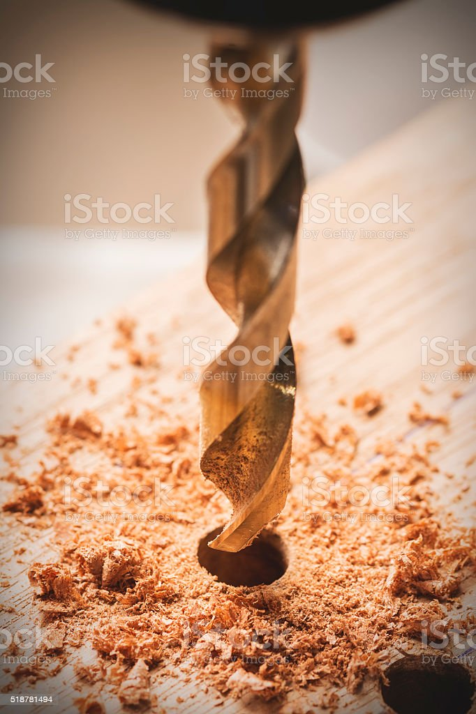 Macro photo of a driil drilling a wood. stock photo