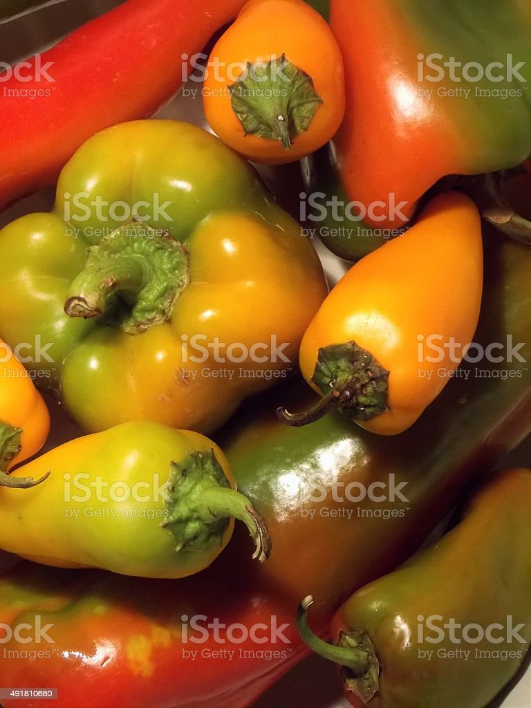 Macro Photograph - 'Brightly Colored Yellow, Green, and Orange Peppers' stock photo