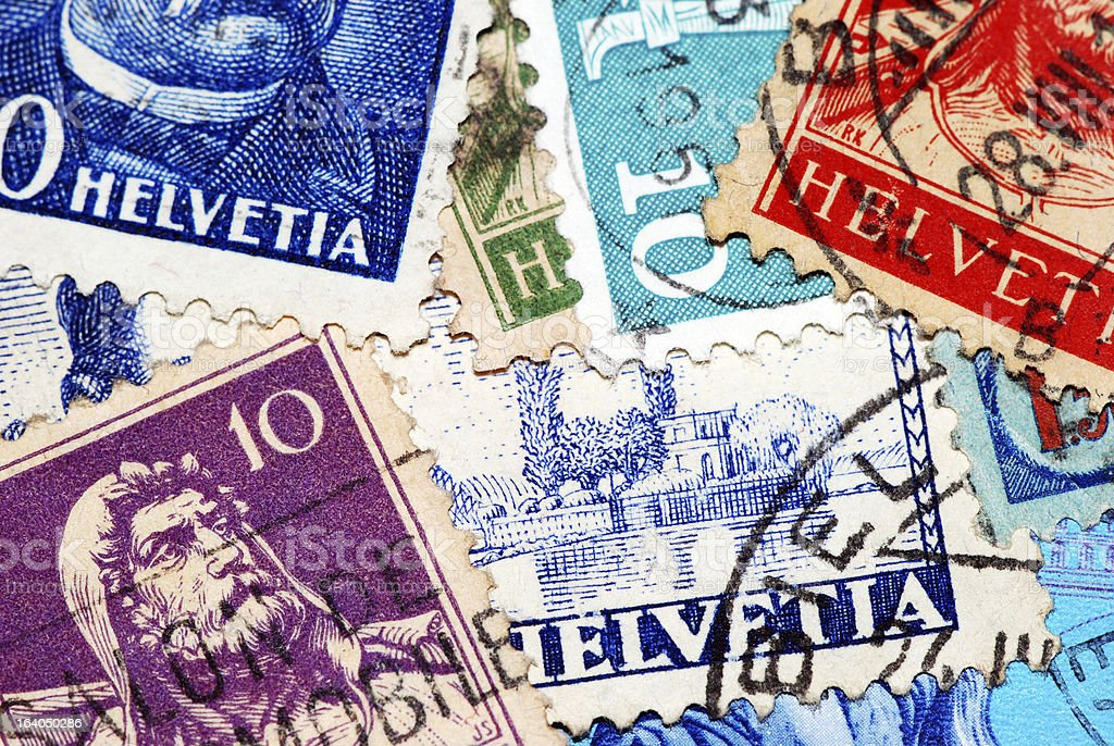 Macro photograph collection of antique Swiss postage stamps royalty-free stock photo