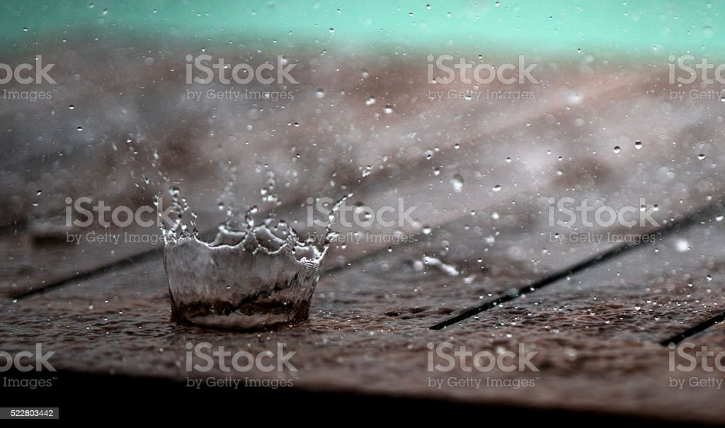 Macro photography of splashing droplet in a form of crown. stock photo