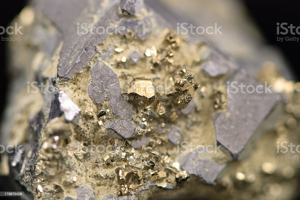 Macro picture of a raw golden nugget found on a mine stock photo