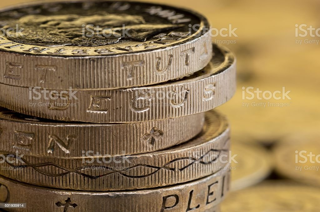 Macro shot of British pound coins in a stack. stock photo
