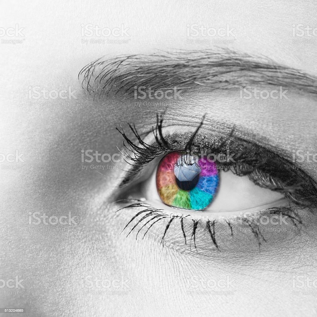 Macro shot of human eye colored in rainbow colors stock photo