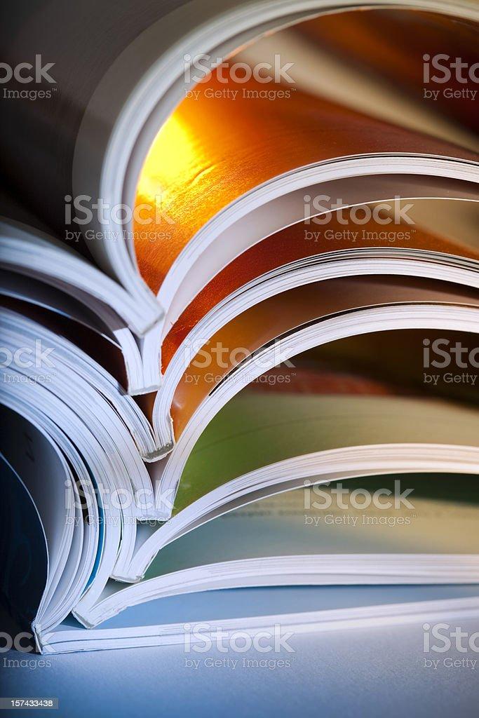 Macro shot of opened magazines stock photo