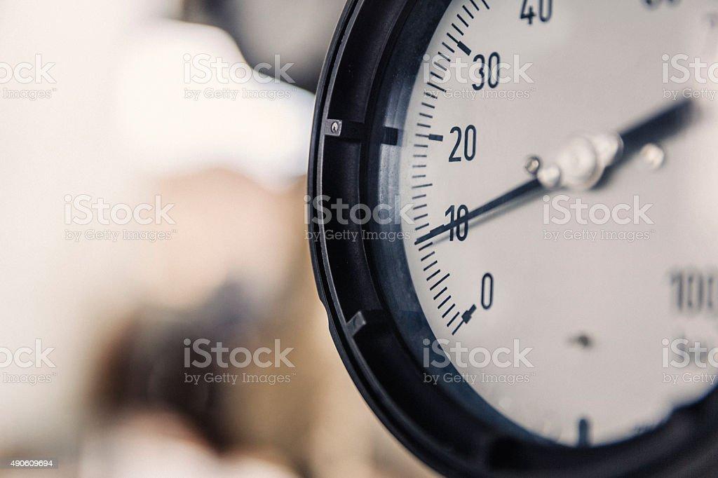 Macro shot of pressure gauge at factory stock photo