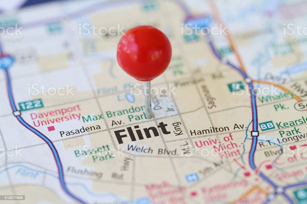 Macro shot of push pin on map of Flint MIchigan stock photo