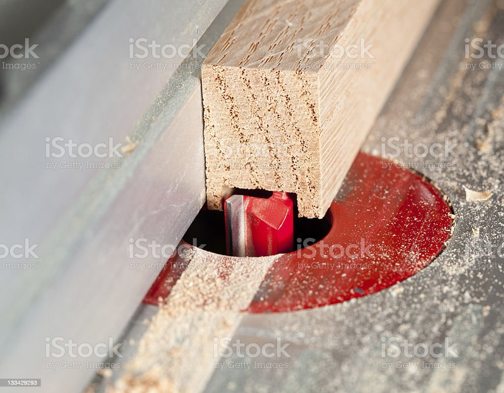 Macro shot of router bit cutting into wood royalty-free stock photo