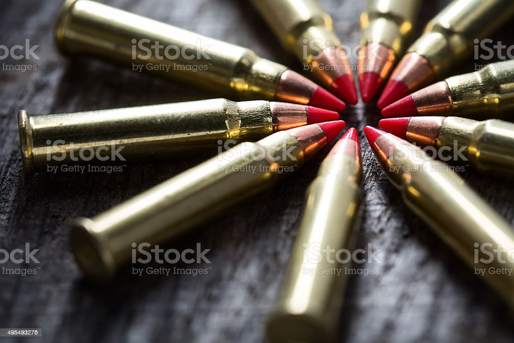 Macro shot of small-caliber tracer rounds with a red stock photo