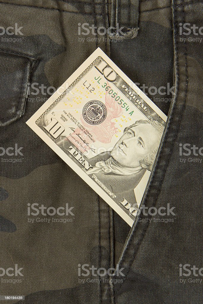 Macro shot of trendy jeans with american 10 dollar bill stock photo