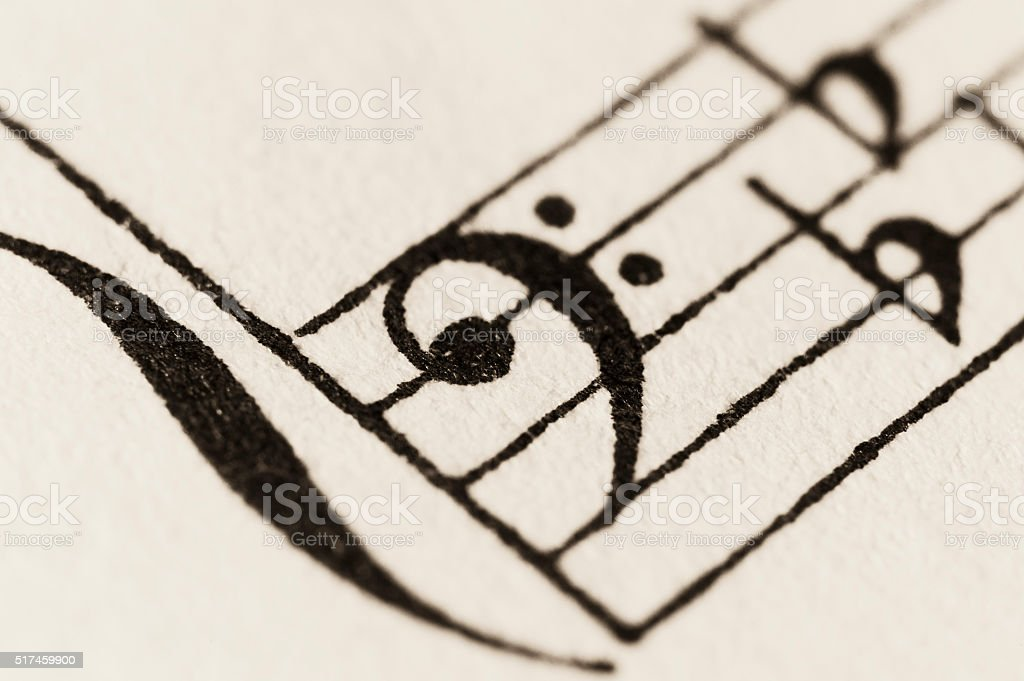 Macro shot of vintage sheet music - bass clef stock photo