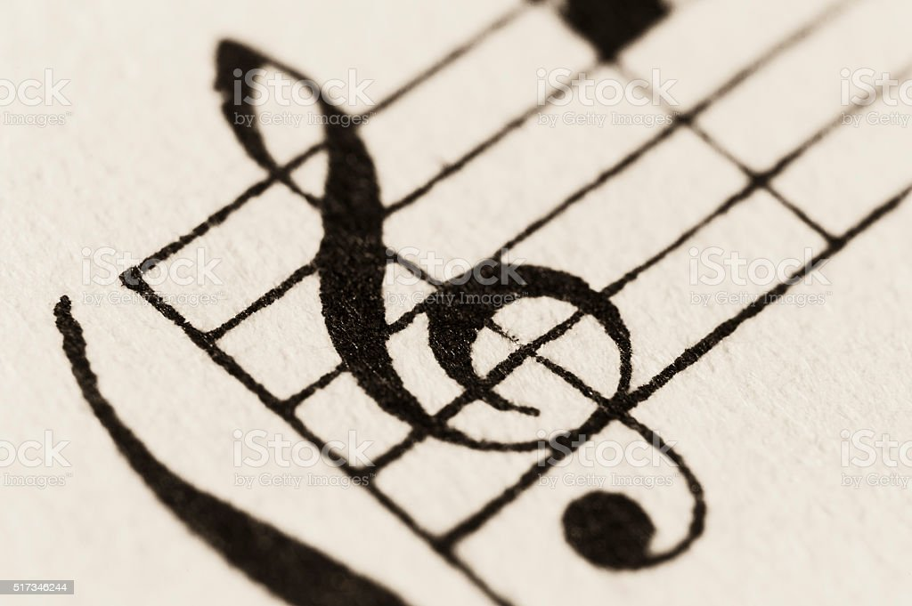 Macro shot of vintage sheet music - treble clef (G) stock photo