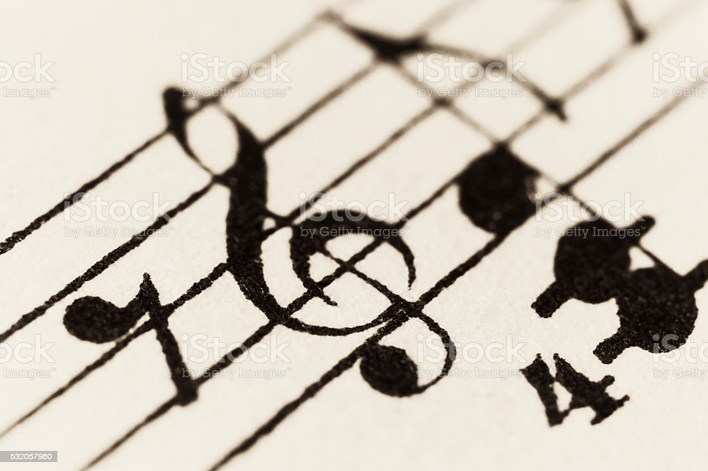 Macro shot of vintage sheet music - treble clef (G) stock photo