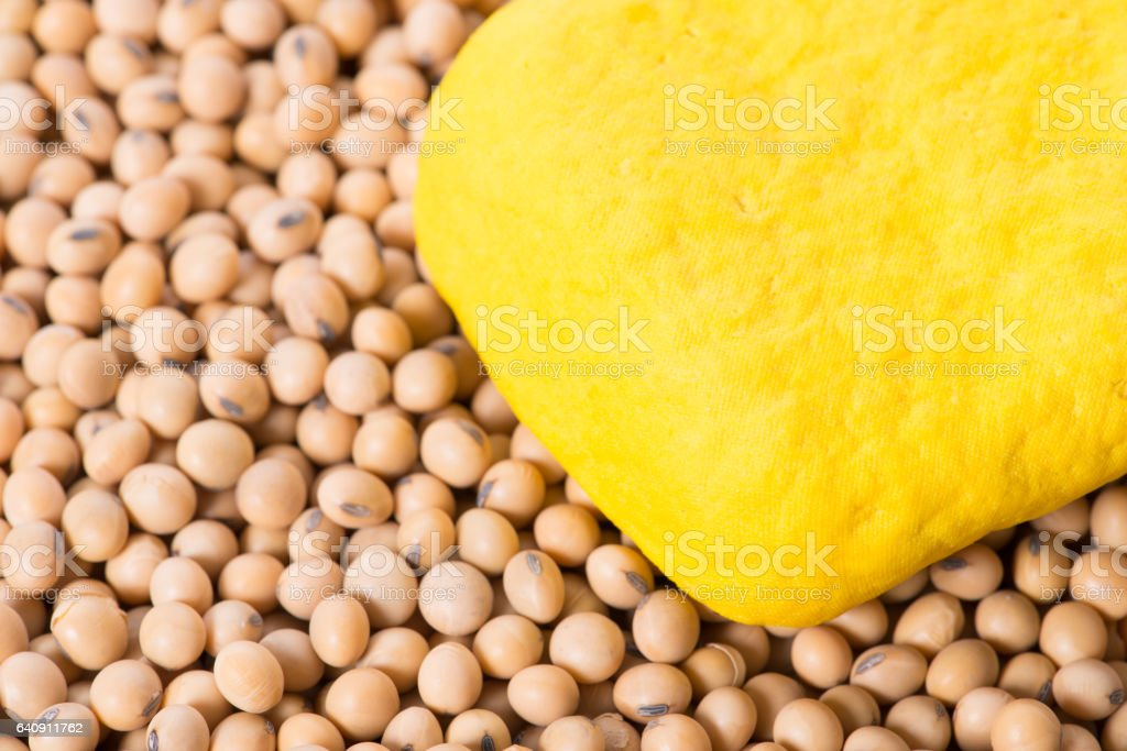 Macro shot of yellow tofu and soy beans stock photo