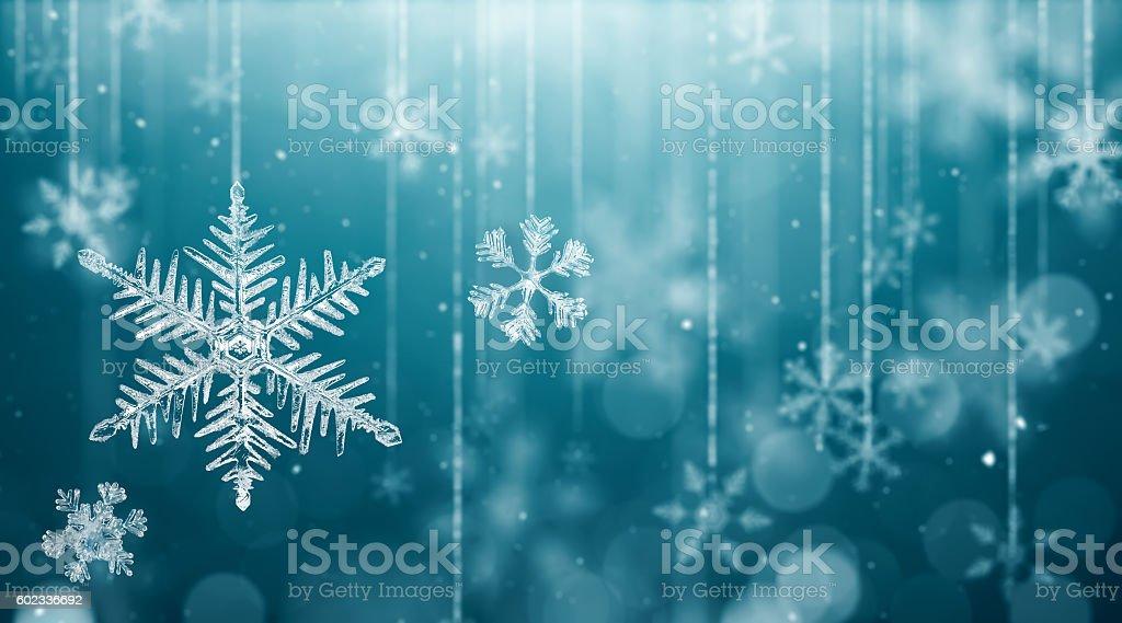 Macro Snowflake and Fallen Defocused Snowflakes stock photo