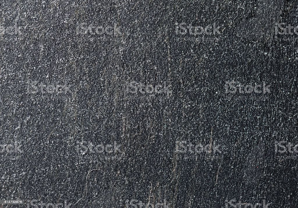 Macro texture of dark brushed scratched metal stock photo