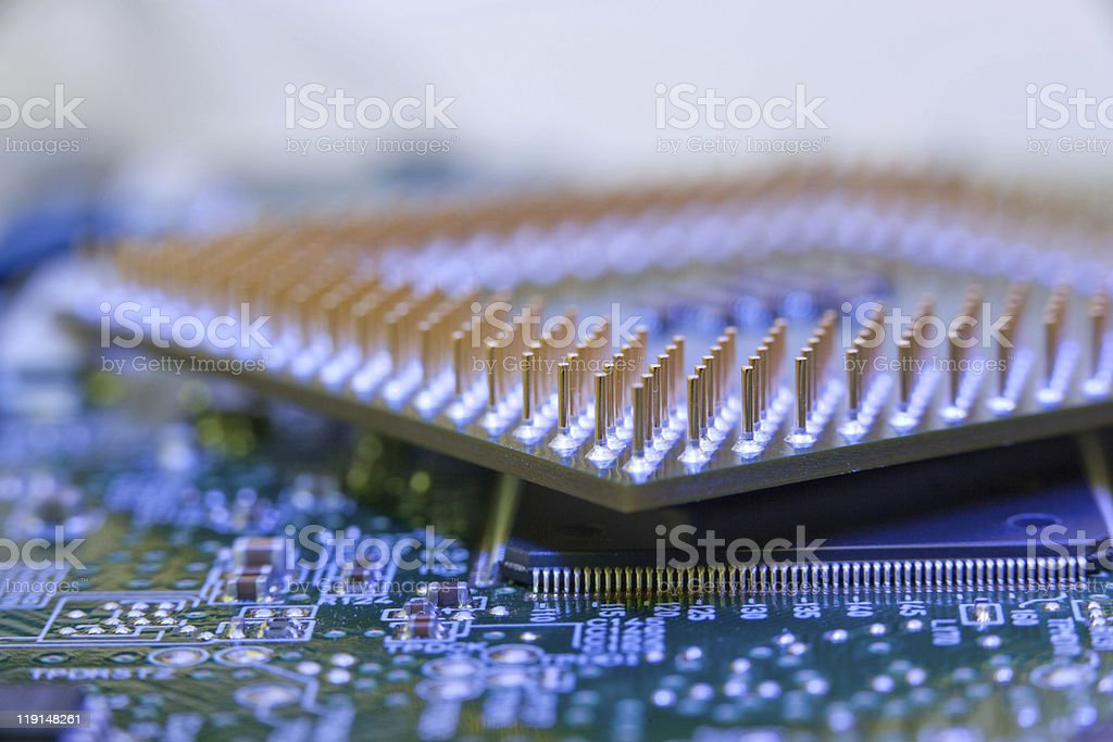 macro view of cpu pins and circuit mother board stock photo