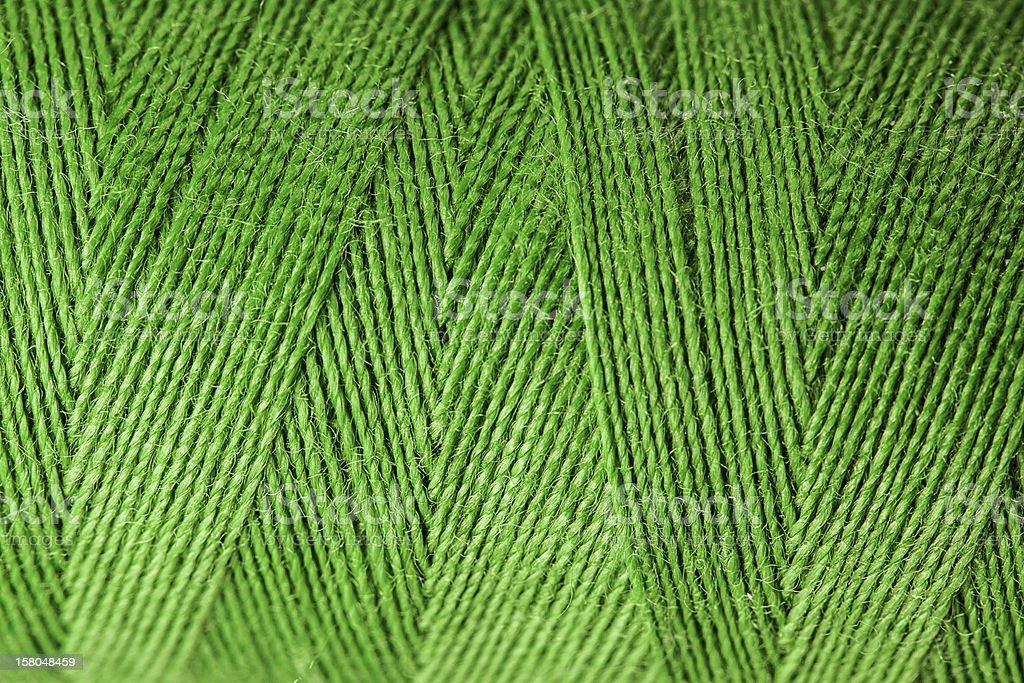 Macro view of green thread wound on a spool royalty-free stock photo