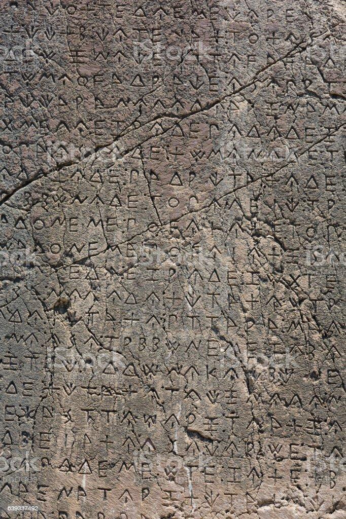 Macro view of script on Inscribed Pillar in Xanthos stock photo