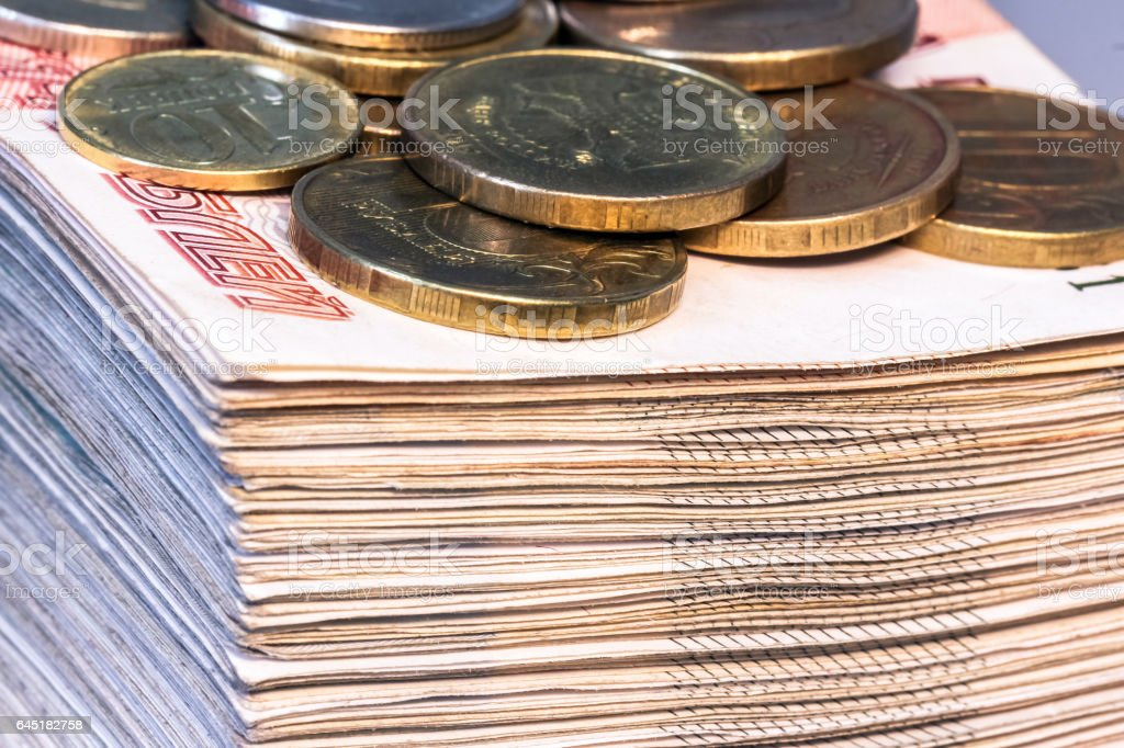 Macroscopic view of corner of huge pile of money with various coins stock photo