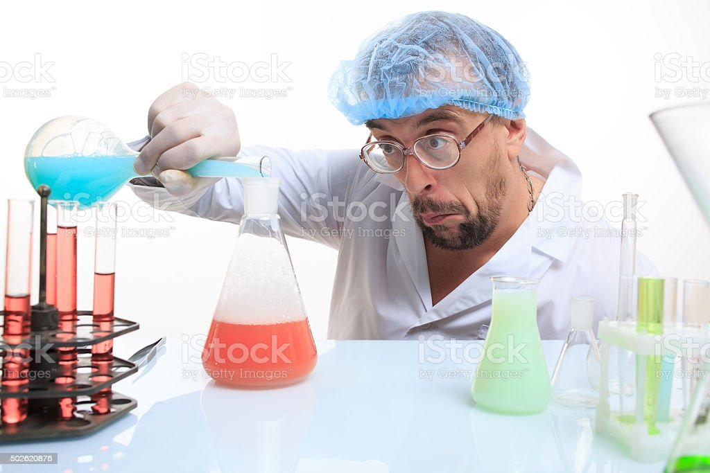 Mad chemist in the lab doing reaction stock photo