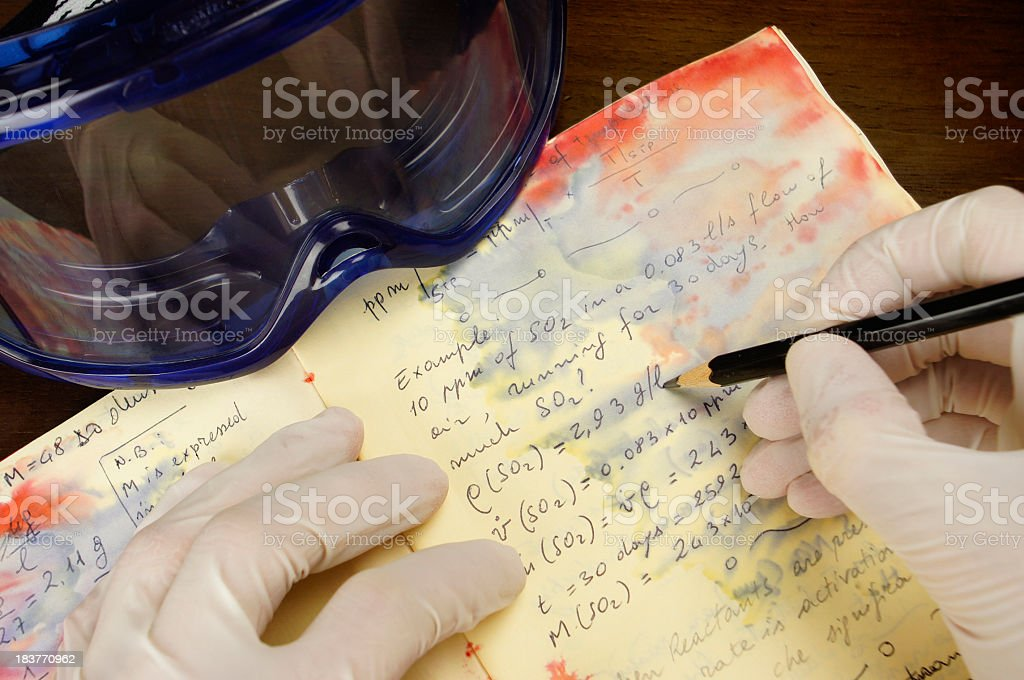 Mad chemist's diary - POV while writing and taking notes stock photo