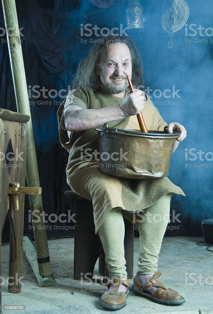 Mad cook with pot stock photo
