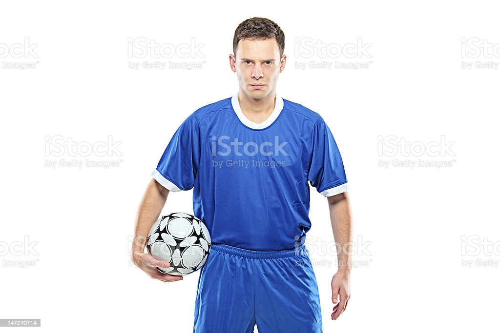 Mad footballer holding a football royalty-free stock photo