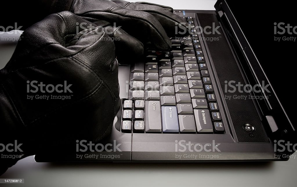 Mad hacker working on laptop at night royalty-free stock photo