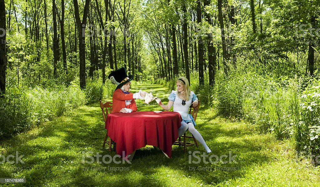 Mad Hatter and Alice stock photo