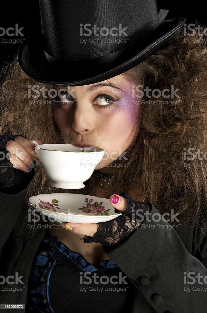 Mad Hatter drinking tea. stock photo