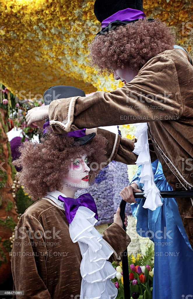 Mad hatters fixing their clothing royalty-free stock photo