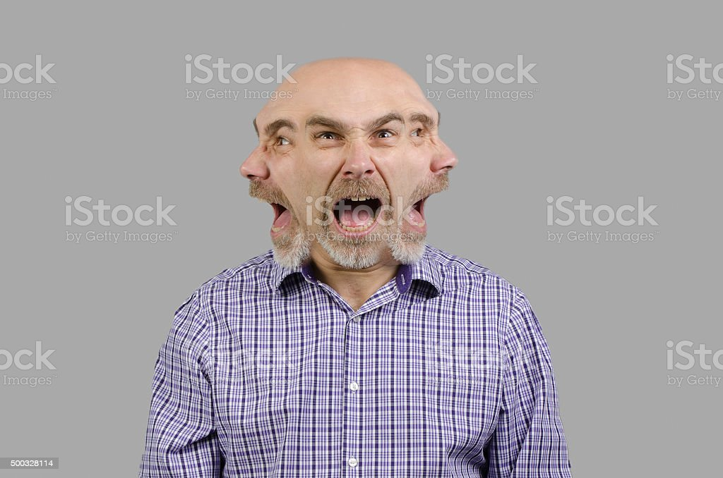 Mad man with three faces shouts on each side. stock photo