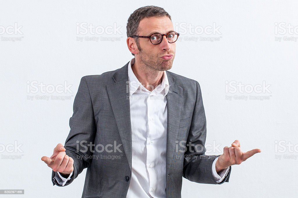 mad middle aged entrepreneur with eyeglasses accusing or denouncing stock photo