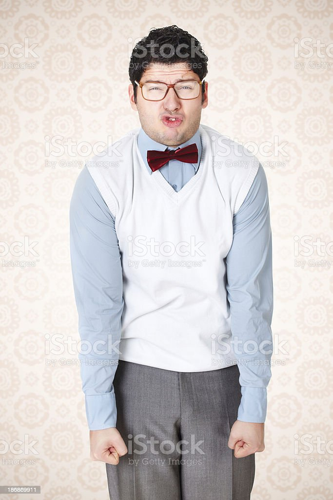 Mad nerdy businessman with glasses strongly holding his fists stock photo