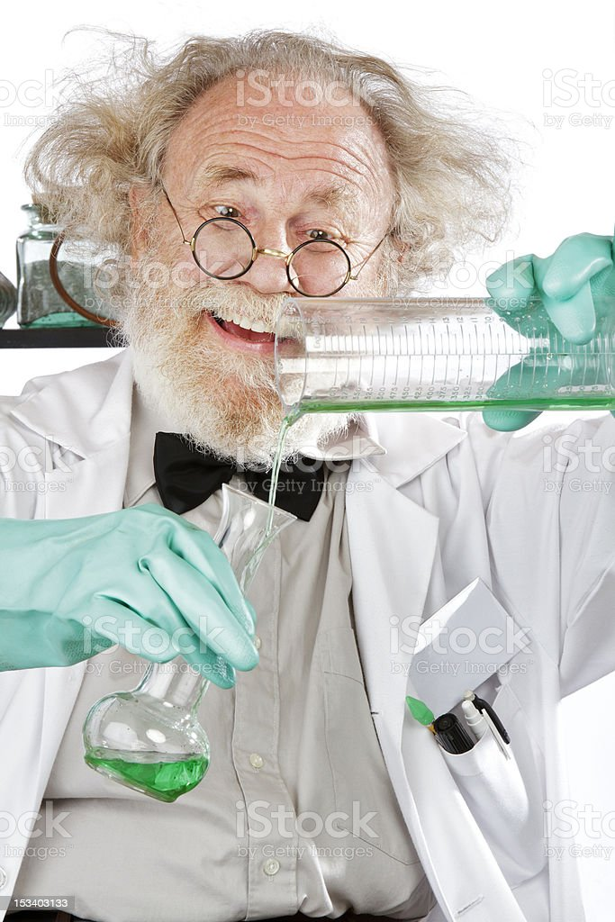 Mad scientist conducts chemistry experiment in his lab royalty-free stock photo