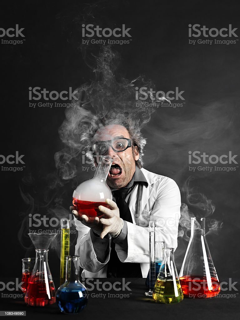 Mad scientist holding hot substance stock photo