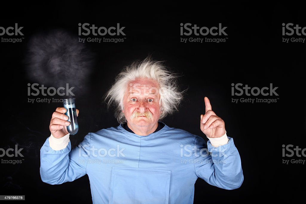Mad scientist nutty professor is doing experiment stock photo