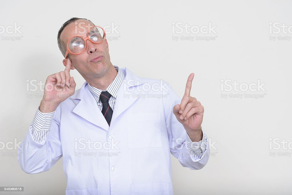 Mad scientist thinking stock photo