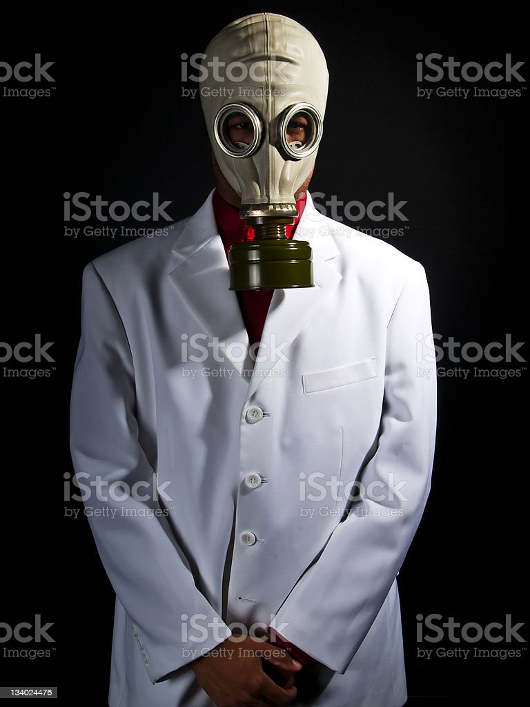 Mad Scientist Wearing a Gas Mask and Lab Coat stock photo