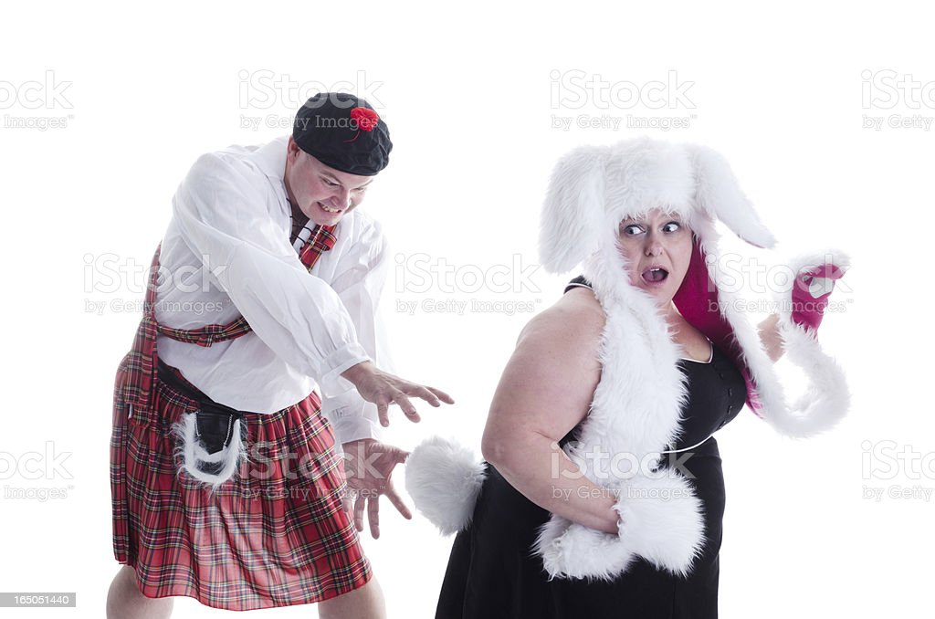 Mad Scot chasing Easter Bunny. stock photo