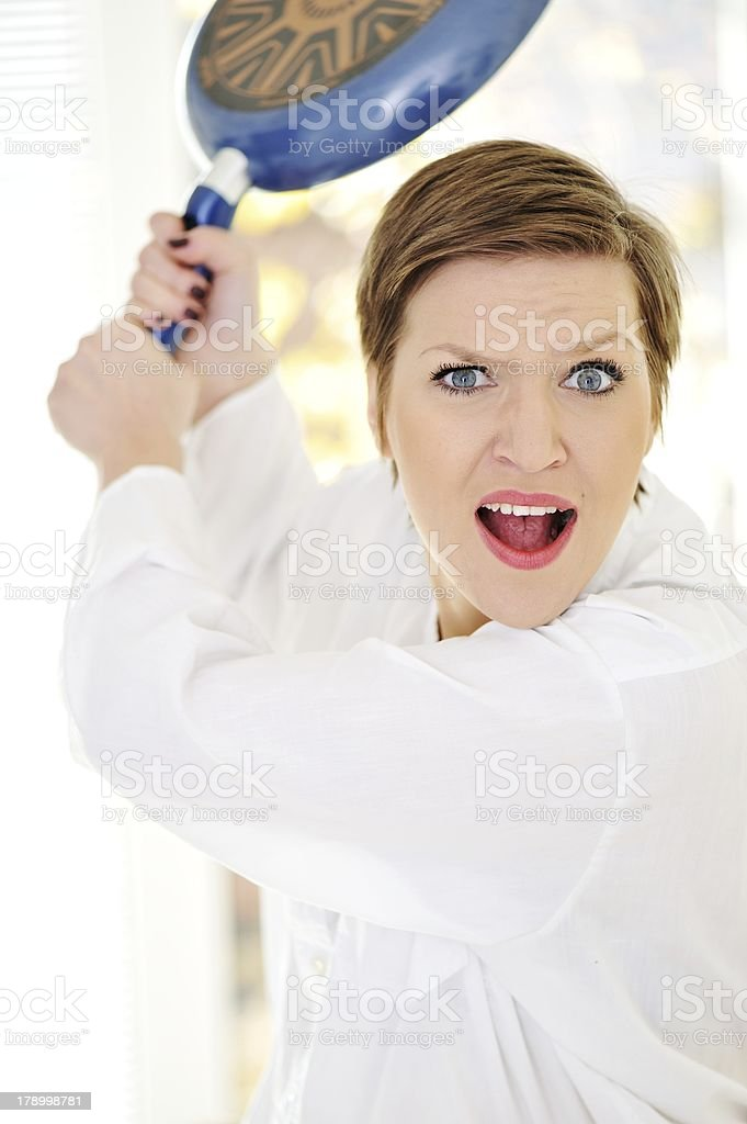 Mad woman with pan in hands royalty-free stock photo