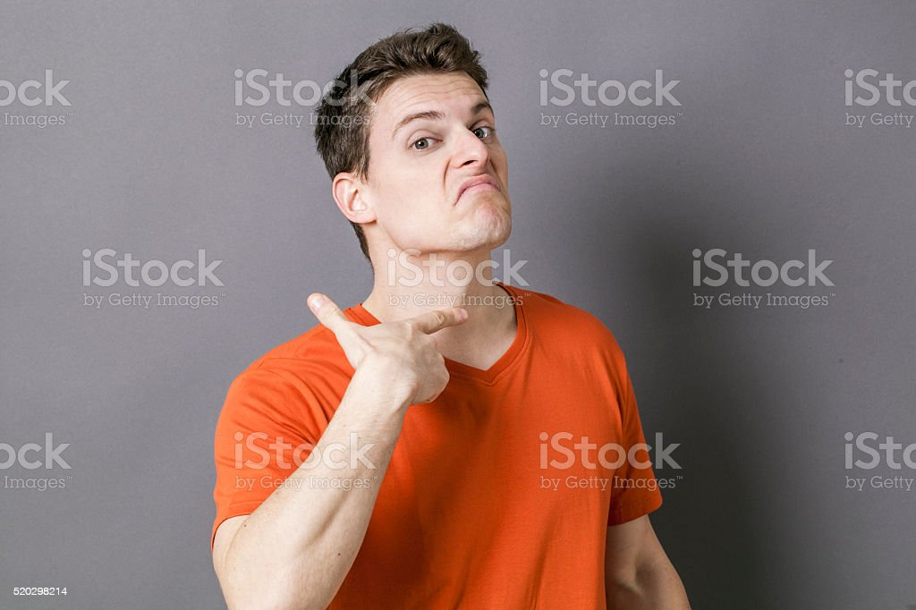 mad young sportsman showing his throat for sign of victim stock photo