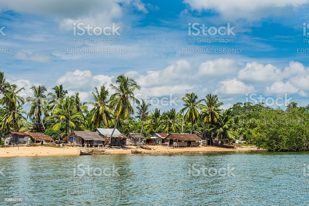 Madagascar Nosy Be island village and fisherman pirogues canoes stock photo