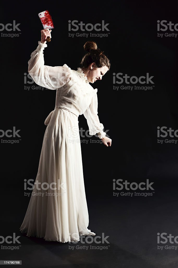 Maddened Victorian maiden brandishes bloodstained cleaver stock photo