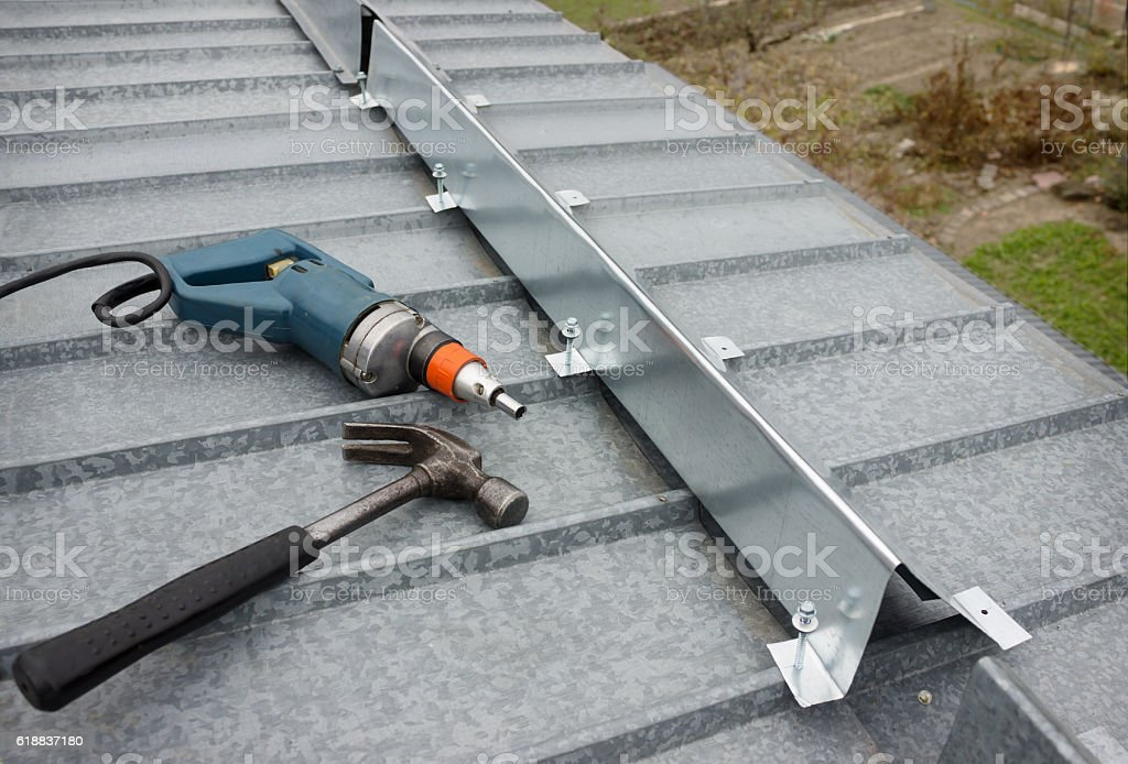 Made a barrier to snow guard on roof edge stock photo