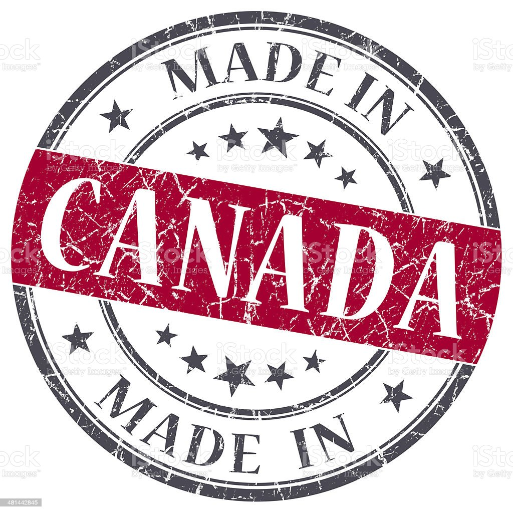 made in Canada red grunge round stamp stock photo