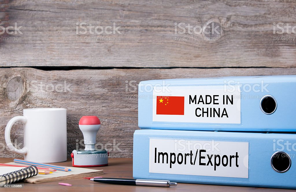 Made In China. Two binders on desk in the office stock photo