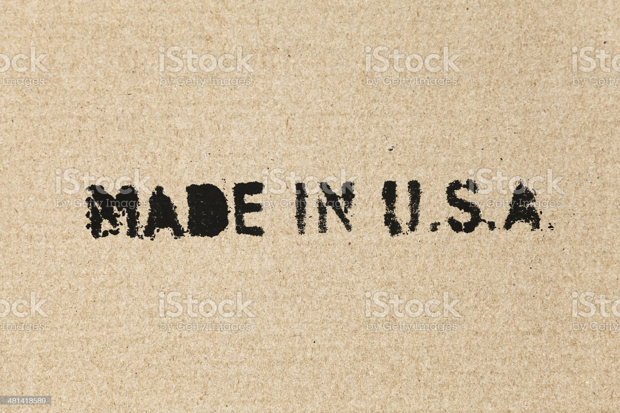 Made in USA. Black label on brown cardboard box royalty-free stock photo