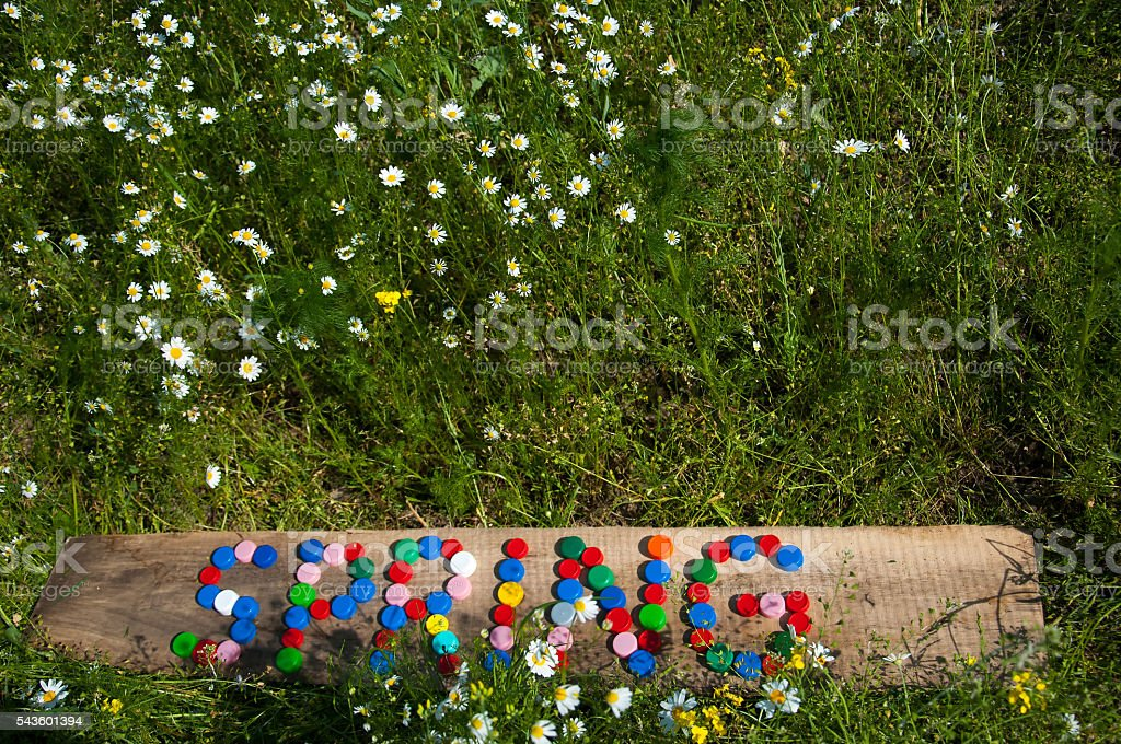 SPRING made of plastic caps stock photo