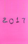 2017 made with glitter on pink background